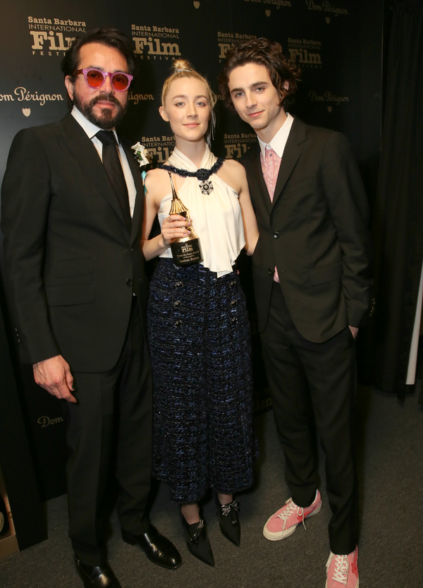 SBIFF executive director Roger Durling, actors Saoirse Ronan and Timothee Chalamet pose backstage with the Santa Barbara Award at the Santa Barbara Award Honoring Saoirse Ronan Presented By UGG during The 33rd Santa Barbara International Film Festival at