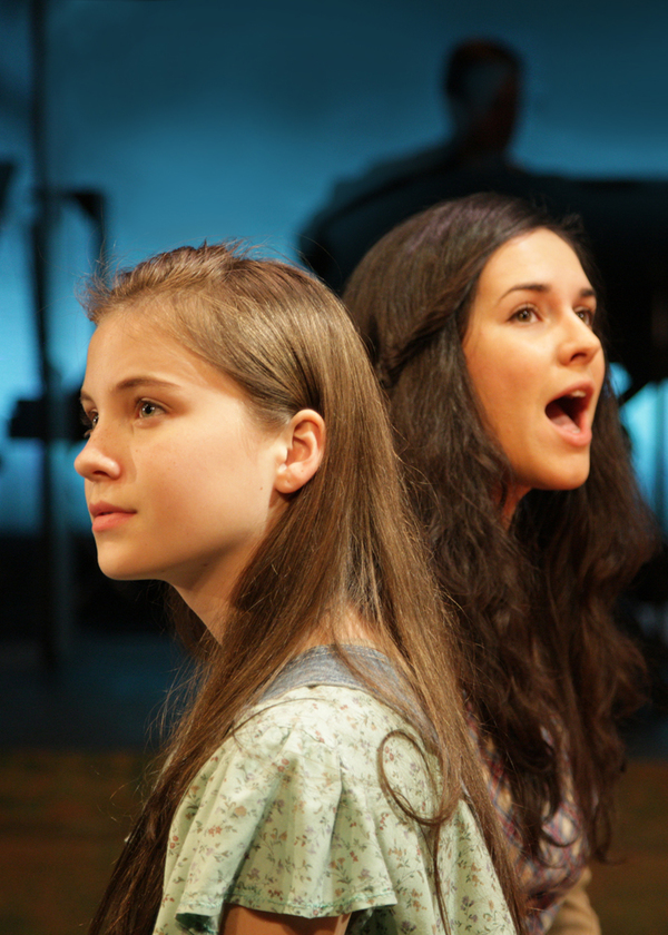 Rebeka Hoblik as Young Violet and Monika Peña as Violet Photo