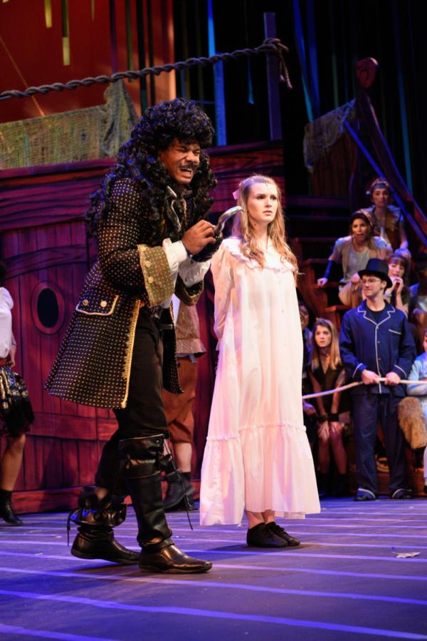 Captain Hook (McLeod Buckham White) enjoys holding Wendy (Madison Thompson) captive before she walks the plank.