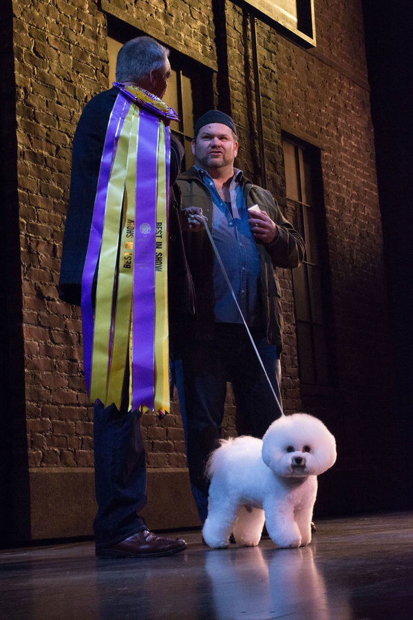 Flynn (with his handler Bill McFadden) on stage with Daniel Stewart Sherman. Photo by Dean Jones.