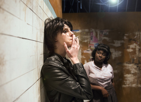 Katie Griffith, left, rehearses a scene from the Penn State Centre Stage premiere presentation of Love In a Hate Nation with fellow cast member Amina Faye at the Playhouse Theatre.