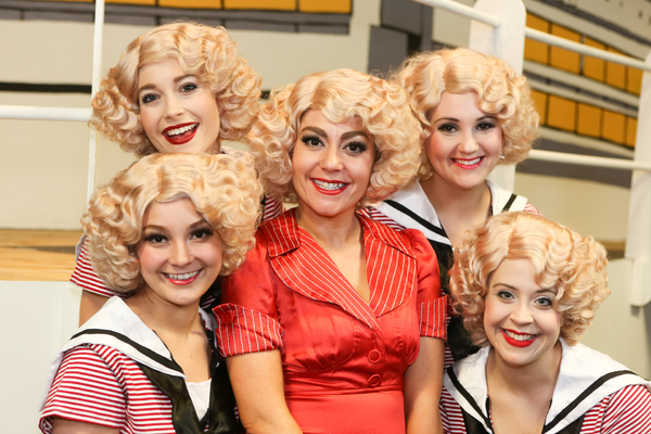 Sarah Porter as Reno Sweeney (center), surrounded by her Angels (clockwise from left) Alyssa Wolf, Larissa White, Michelle Sauer, and Sara Rae Womack, in New Line Theatre's ANYTHING GOES. Photo credit: Jill Ritter Lindberg.