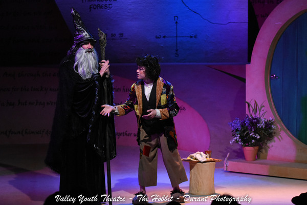 Zachary Holmes as Gandalf with Matthew Syms as Bilbo Baggins