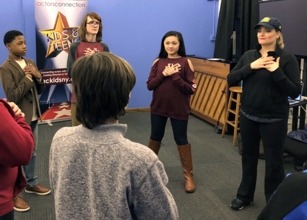 Broadway's Gaelen Gilliland warms up the group of students before teaching them a musical lesson at Actors Connection New York.