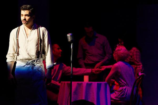 Michael McCray (Che) and the Evita ensemble