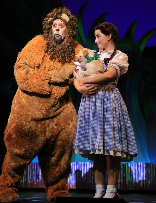Dorothy (Kalie Kaimann), Toto (Murphy) and Lion (Victor Legarreta)  Photo