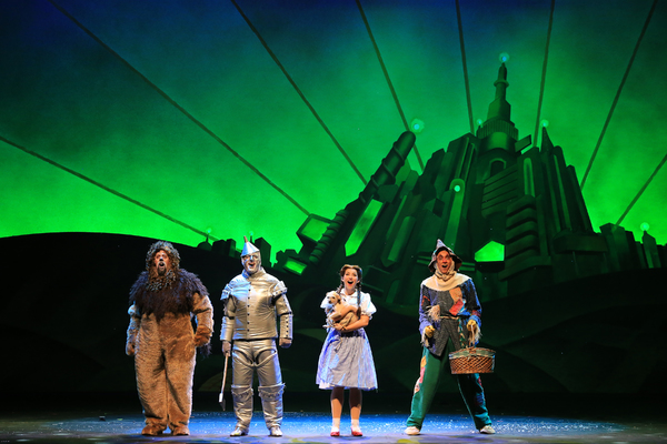 Lion (Victor Legarreta), Tin Man (Christopher Russell), Dorothy (Kailee Kaimann), and Scarecrow (Chris Duir) are welcomed to the Emerald City