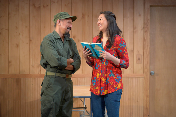 Bobby (Jomar Tagatac, left), an American soldier at Fort Chaffee, is smitten with Tong (Jenelle Chu, right)