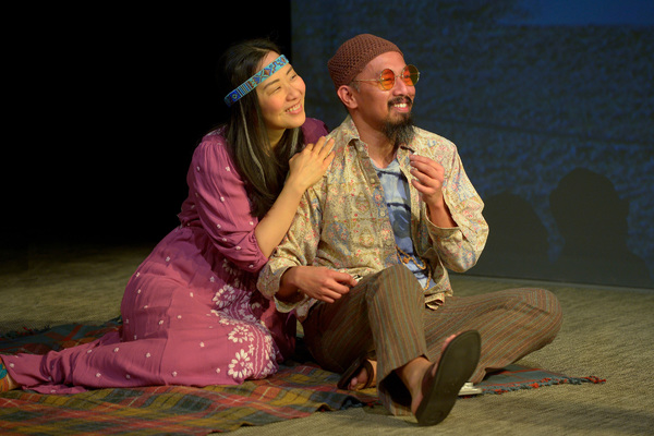 Two hippies (Cindy Im, left, and Jomar Tagatac) smoke a joint