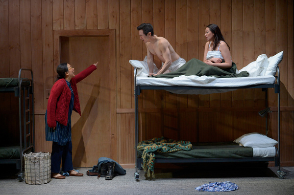 Huong (Cindy Im, left) walks in on Quang (James Seol, center) and Tong (Jenelle Chu, right) in bed. Photo Credit: Kevin Berne