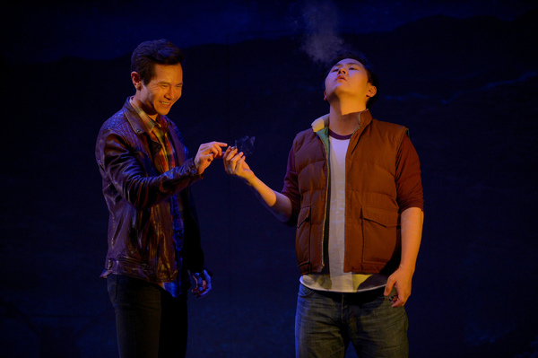 Quang (James Seol, left) and Nhan (Stephen Hu, right) share a joint during their trip from Arkansas to California. Photo Credit: Kevin Berne