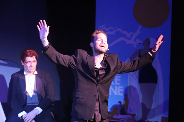 "Aaron Allen as Moonface Martin (front) singing ""Be Like the Bluebird,"" with Evan Fornachon as Billy"