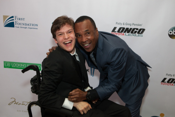 Micah Fowler and Sugar Ray Leonard at United Cerebral Palsy Los Angeles' Art of Care Gala where Fowler was honored with the Trailblazer Award.
