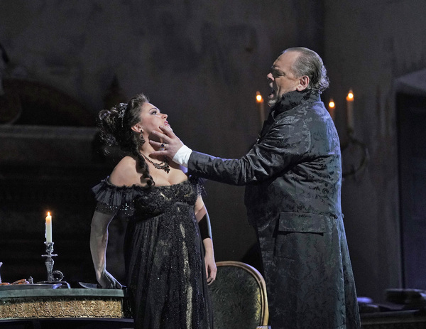 """Anna Netrebko in the title role and Michael Volle as Scarpia in Puccini's """"Tosca."""" Photo: Ken Howard / Met Opera"""