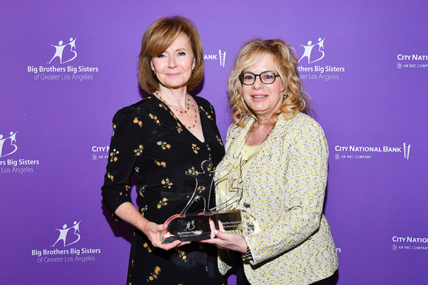 BBBSLA Board Chair Laura Lizer (right) presented the Innovator Award to the EVP of Entertainment Banking at City National Bank Martha Henderson for introducing the BBBSLA Workplace Mentoring Program to City National Bank.