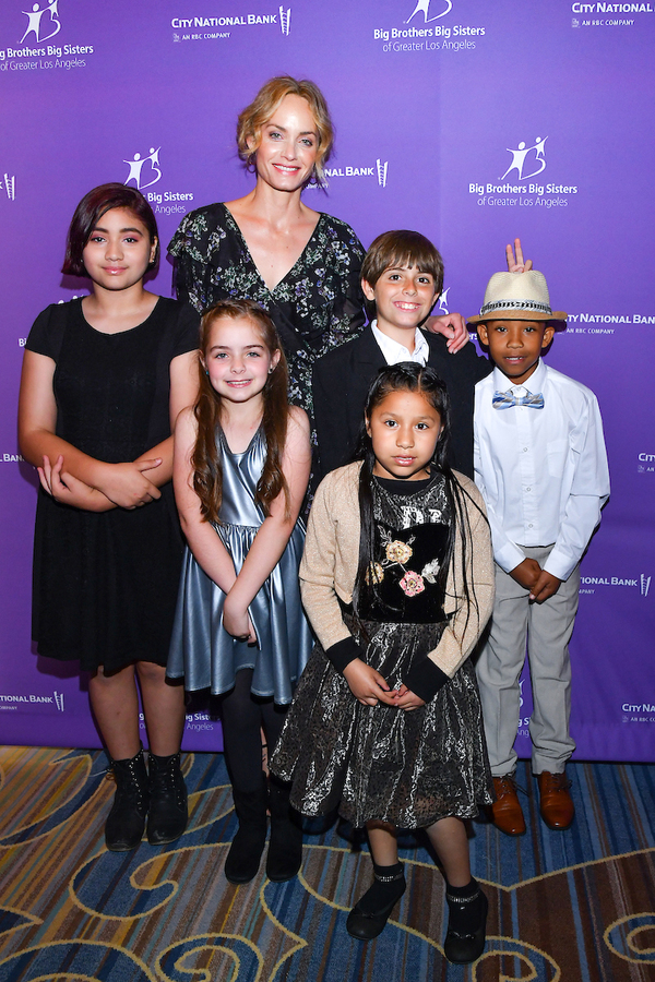 Actress and model Amber Valletta and little brothers and sisters who walked in the BBBSLA Accessories For Success Luncheon fashion show.