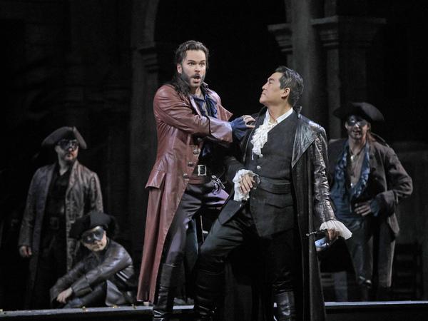 Joshua Hopkins as Mercutio and Andrea Shin as Roméo in Gounod's Roméo et Juliette. Photo by Ken Howard / Met Opera