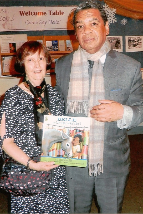 """Linda Rousseau (left) of The All Souls Peace and Justice Task Force (PJTF) greets author / playwright Calvin Alexander Ramsey (right) following the performance of the adaptation of his children's book """"The Last Mule At Gee's Bend"""" which was recently prese"""
