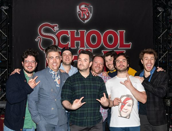 "Past and present Dewey Finns of School of Rock â€"" The Musical. Left to Right: Will Blum, Eric Petersen, Andrew Kober, Alex Brightman, Michael Hartney, Jonathan Wagner, Justin Collette (holding Merritt David Janes) & Conner Gillooly"