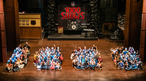 The Musical cast members, including Justin Collette and Alex Brightman (front row of second zero) form the number 1,000 on stage at the Winter Garden Theatre