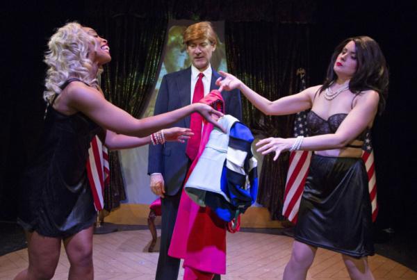 The stained blue dress incident. Latonia Phipps as Ivanka, Ezra Barnes as Donald Trump & Stephanie Fredricks as Melania. Photo by Joseph Henry Ritter.