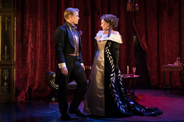 Freddie Fox as Lord Goring, Frances Barber as Mrs Cheveley Photo