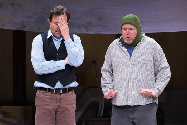 Robert de Baudricourt (Eric Tucker) grows exhausted with his steward (Edmund Lewis)