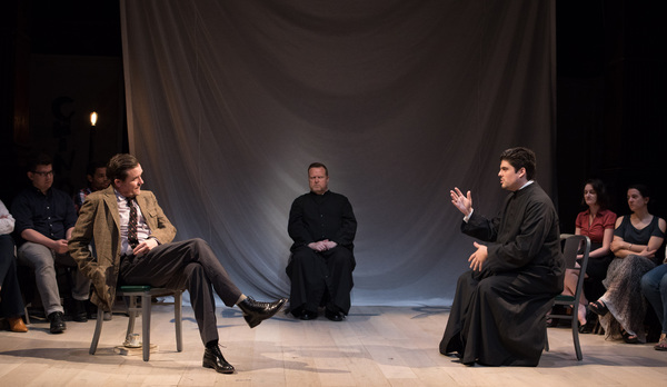 The Earl of Warwick (Eric Tucker, left) discusses the fate of Joan of Arc with the Bishop of Beauvais (Sam Massaro), as chaplain John de Stogumber (Edmund Lewis) listens intently