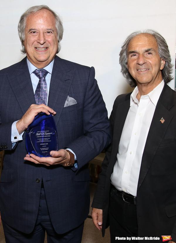 Stewart F. Lane and executive director Howard Teich