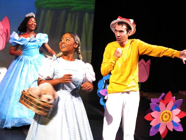 L-R: Barbyly Noel (Glinda), Taylor-Rey Rivera (Dorothy), Ben Harburg (ensemble).  Photo by Jonathan Slaff.