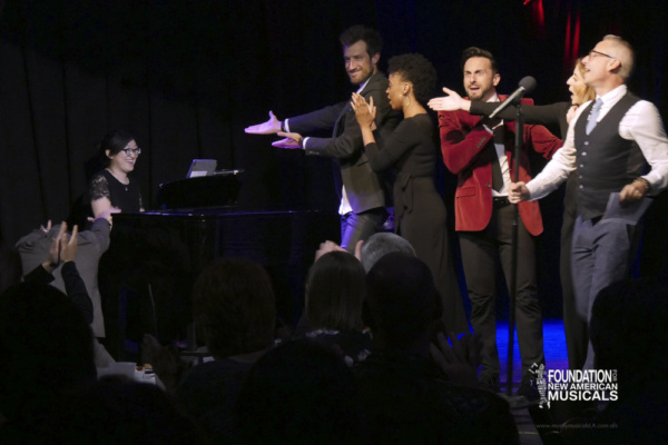 the cast and audience show their appreciation for music director Jennifer Lin Photo