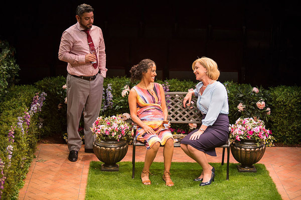"""(from left) Eddie Martinez as Pablo Del Valle, Kimberli Flores as Tania Del Valle, and Peri Gilpin as Virginia Butley in Native Gardens, written by Karen Zacarías, and directed by Edward Torres, running May 26 â€"""" June 24, 2018 at The Old Globe. Photo by"""