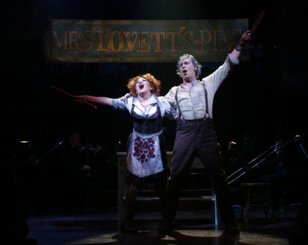 Liz Larsen as Mrs. Lovett and Terrence Mann as Sweeney Todd