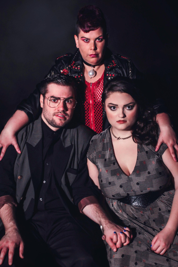 Suzan M. Jacokes (center) stars as Dr. Frank N. Furter, Matt Wallace (left) is Brad M Photo