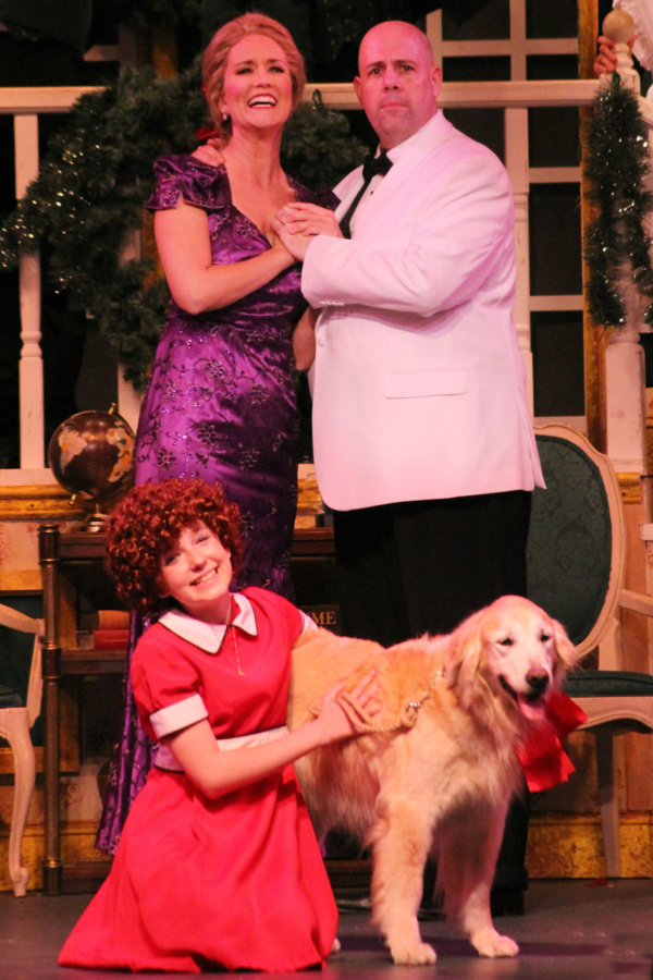 Piper Sobon as Annie, Peyton as Sandy, Melissa Whitworth as Grace and Victor Legarreta as Oliver Warbucks