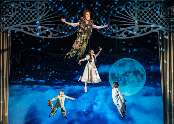 Peter Pan (Johnny Shea) leads the Darling siblings (Carter Graf, Elizabeth Stenholt, and Cameron Goode) on a high-flying adventure to Neverland in Peter Pan – A Musical Adventure, directed and choreographed by Amber Mak, in the Courtyard Theater, June 2