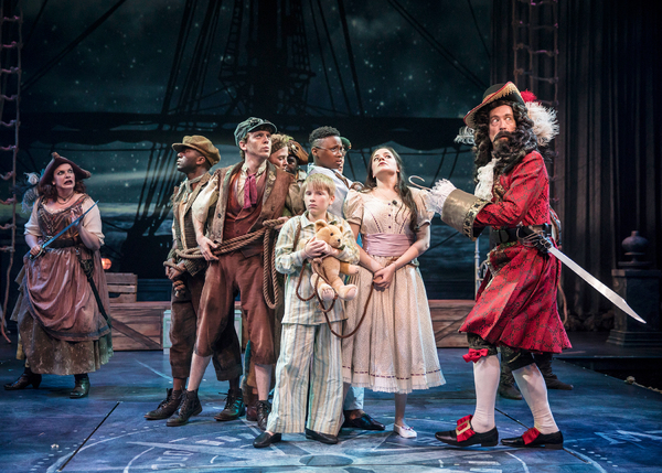 """Captain Hook (James Konicek) is startled by the sound of the dreaded ticking crocodile while taunting the captured Lost Boys and Darling siblings, with the help of Starkey (Christina Hall) in Peter Pan â€"""" A Musical Adventure, directed and choreographed b"""