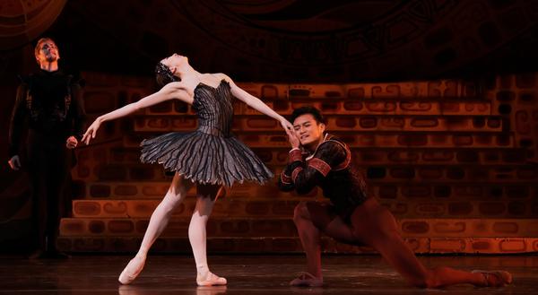 Houston Ballet Principals Yuriko Kajiya as Odile and Chun Wai Chan as Siegfried with Soloist Christopher Coomer as Rothbart in Stanton Welch's Swan Lake.
