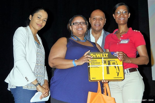 BSDC / Lowe's Dewalt Drill raffle winner   Angela Miller (second from left) is congra Photo