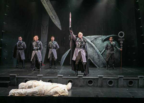 Bruce Cromer as Titus Andronicus with the company of Titus Andronicus