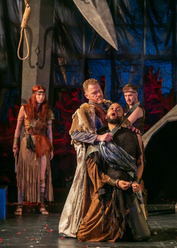 Clark Scott Carmichael as Lucius and Chris White as Aaron with the company of Titus A Photo