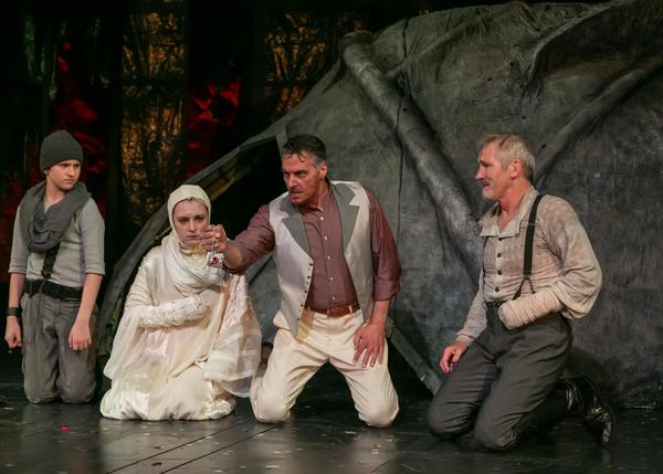 AJ DeAugustine as young Lucius, Fiona Robberson as Lavinia, Robert Cuccioli as Marcus, and Bruce Cromer a Titus Andronicus. Photo credit: Jerry Dalia.