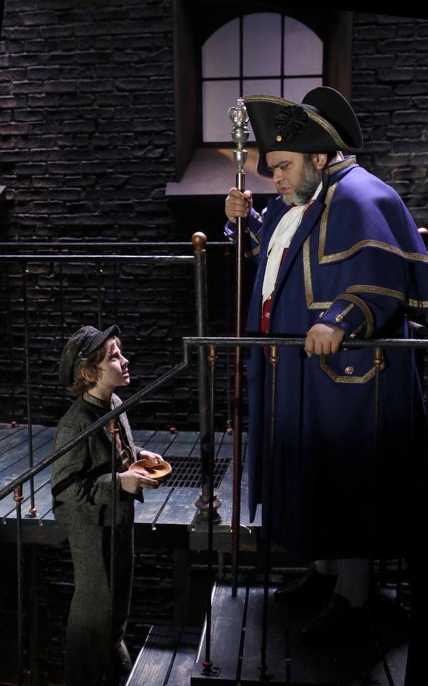 Elijah Rayman (Oliver Twist) and Richard Henry (Mr. Bumble) in Goodspeed Musicals' Oliver!