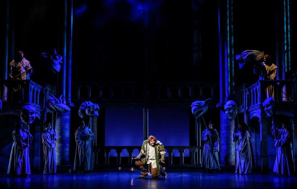 David  Burnham  (center)  as  Quasimodo  and  the  company.