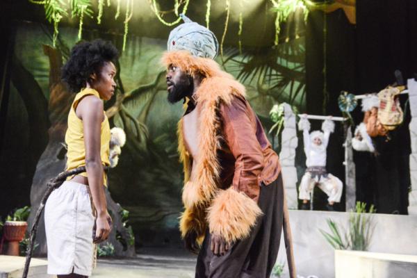 Antonia Elson as Mowgli, Joseph Black as The Monkey King and members of the company i Photo