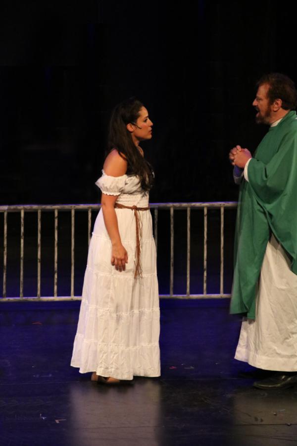 Gina Naomi Baez as Esmeralda and Paul Bogaev as Frollo