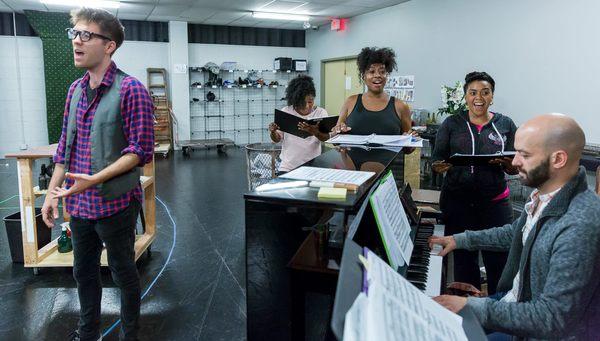 Will Lidke (Seymour), Melanie Brezill (Ronnette), Candace C. Edwards (Crystal), Melanie Loren (Chiffon), and Conductor Chris Sargent