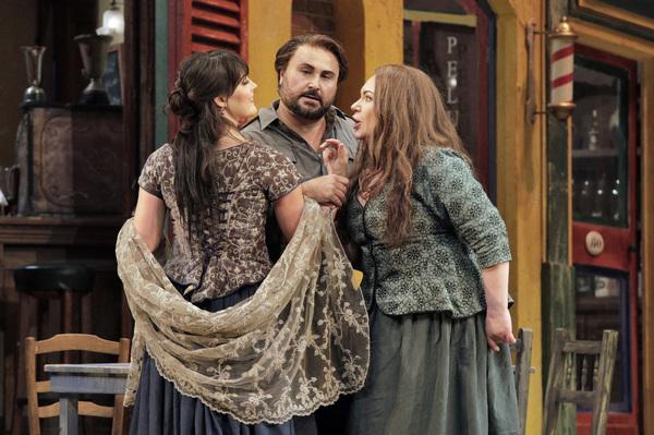 "Laura Krumm as Lola, Roberto Aronica as Turiddu and Ekaterina Semenchuk as Santuzza in Mascagni's ""Cavalleria Rusticana."""