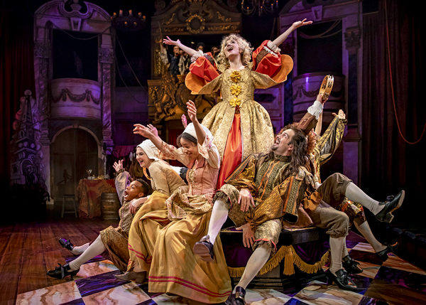 Nell Gwynn (Scarlett Strallen) soars in a musical number with the company in Chicago Shakespeare's North American premiere production of Nell Gwynn