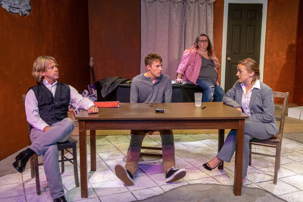 Stephen Woosley as Joyce,  l-r, with  Dustin Schwab as Linden, Mary Sink as Bay, and Colleen Dunne as Petra in MadLab Theatre's production of The Wave That Set The Fire by Ellen K. Graham